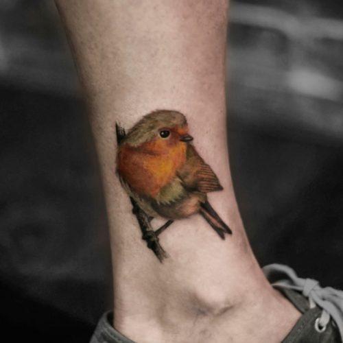 קעקוע ראליסטי של ציפור